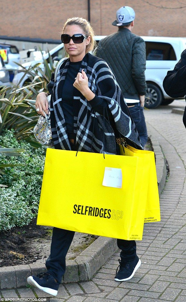 She comes bearing gifts! Katie Price arrived at The Woking Theatre carrying bags of presen...