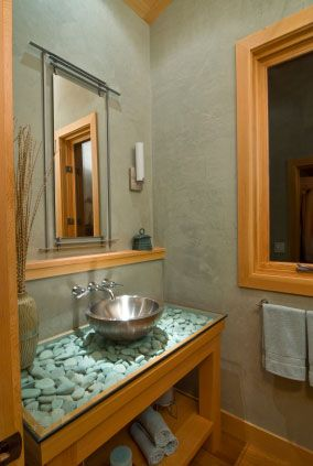 Zen Look Bathroom Vanity With River Rocks Under Glass Top And Vessel Sink Above Bathrooms
