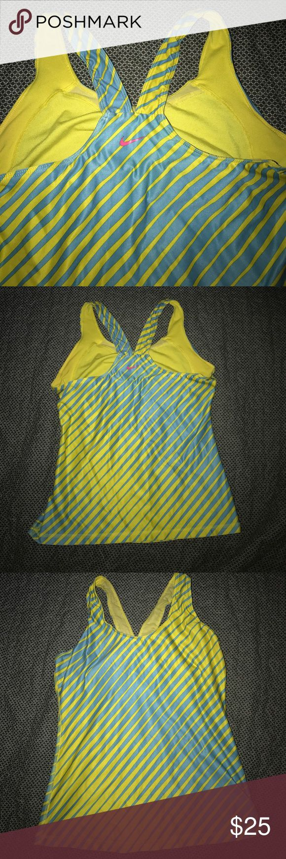 Nike tank top Stretchy Nike tank top with built-in bra. Vibrant blue and yellow with pink Nike swoosh on the back. Good condition. Nike Tops Tank Tops