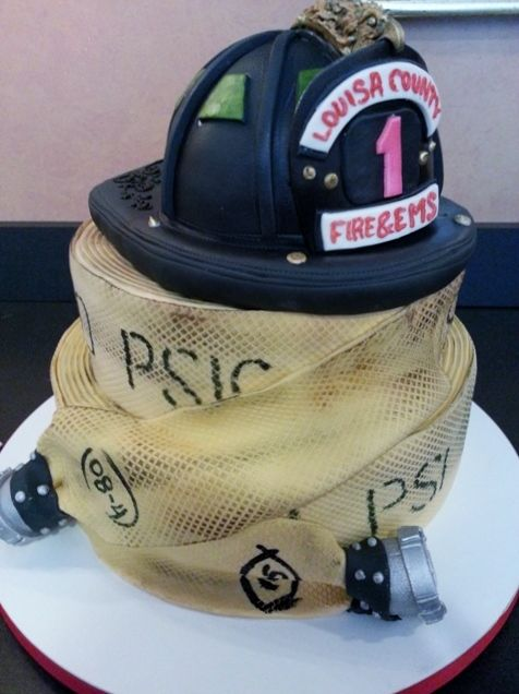 This Fireman's helmet and hose stack is made of cake and rolled fondant.  The details are hand painted, perfect for your groom.  Cakes By Graham, More Than Just the Icing on the Cake.  http://richmondcakes.com/