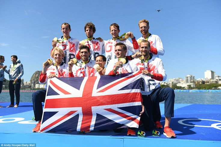 Great Britain's rowing team celebrate with their gold medals after their victory in Rio