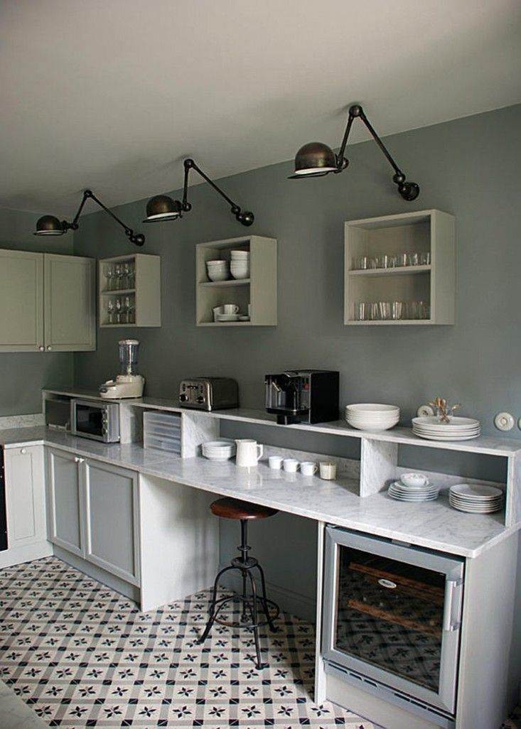 In a kitchen via Plitka in Romania, a trio of Jielde Signal Two-Arm Wall Sconces; $390 each from Horne. | Remodelista