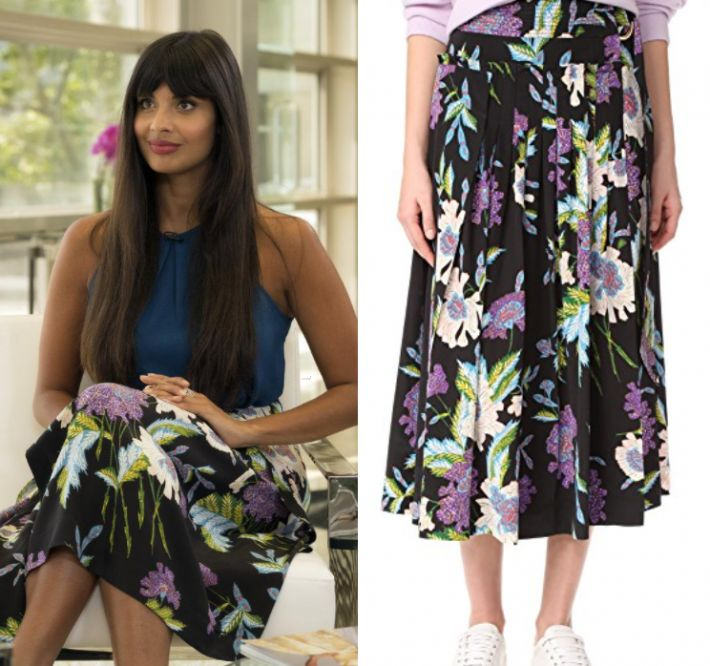 """Tahani Al-Jamil (Jameela Jamil) wears this navy blue floral printed midi skirt in this episode of The Good Place, """"Team Cockroach"""". It is the Diane von Furstenberg D Ring Midi Skirt Curzon Black"""