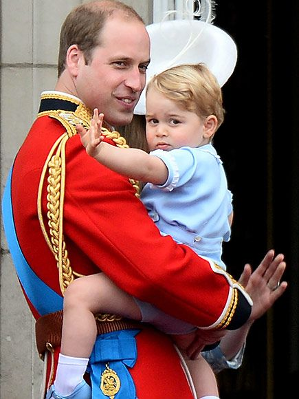 George gives one last wave to his fans before the royal family departs through the large palace doors.