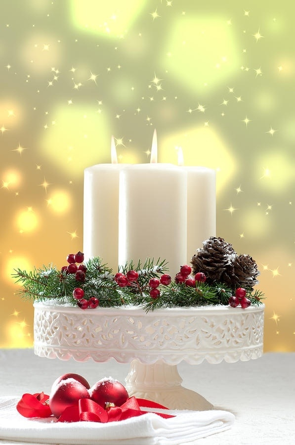 Decorate a Cake Stand with Candles and Christmas ornaments to make an elegant table top for Christmas.