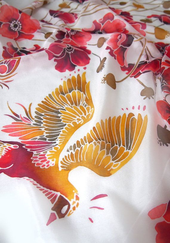 Square scarf Poppy and Firebird is a handpainted silk scarves in fiery red and gold colors on white natural Chinese silk called Habotai. Poppy and Firebird silk scarf was designed to bring strength for whoever wears it! Tangled poppies flowers are a symbol of life force and summer while Firebird is a symbol of life and pure heart.  This square scarves is big: it is approximately 88 x 88 cm (34 x 34 inch) and it is designed so you can achieve different color compositions depending on the way…