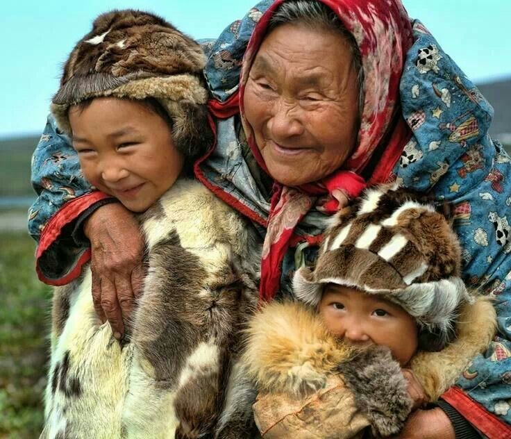 A Yup'ik grandmother poses with her grandchildren for a photograph on the Russian side of the Bering Sea, Chukotka Peninsula, Siberia, Russia, 2012, photograph by Daniel Schual-Berk.
