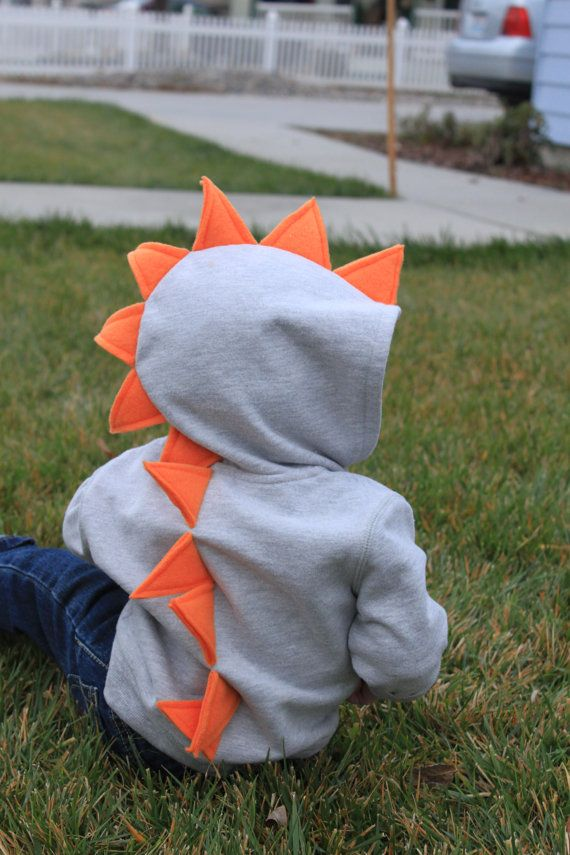RAWR! Every kid loves the dinosaur spiked zip-up hoodies! Hoodies are made using Rabbit Skins brand hoodies and the spikes are made with fleece, NOT felt, to ensure they will last!  *Rabbit Skins does NOT have a 3t, if your little dino is wearing a 3t now, ordering a size 4 is your best bet. The hoodies run pretty true to size but will shrink a bit if you wash/dry on hot.*(Check out my shop for youth sizes)  Hoodie Sizes- 6m, 12m, 18m, 2t, 4t, 5/6 Hoodie Colors- black, gray, navy, light pink…