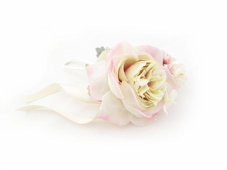 A lush Paris rose wristlet by https://www.loveflowers.com.au