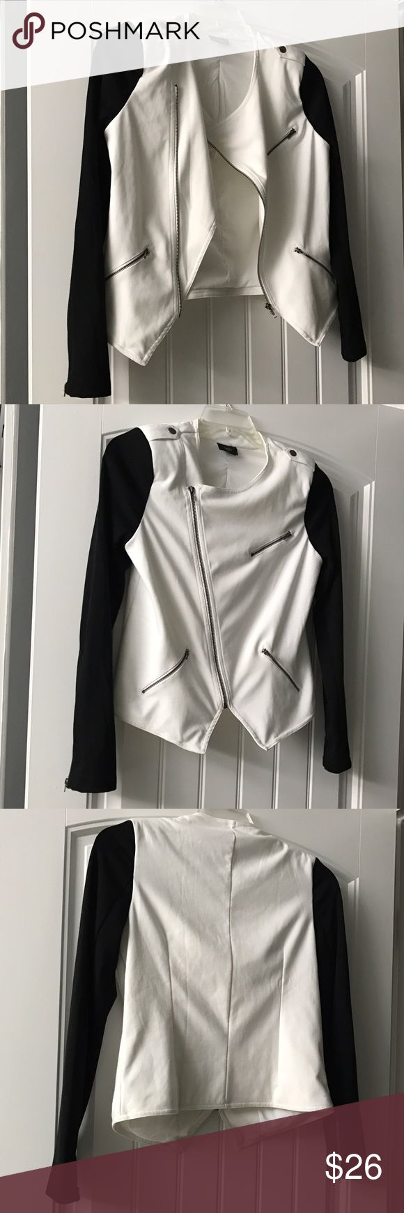 White and black asymmetrical zip jacket. This dressy jacket.  Is great for going out has zippers at wrists and and very classy. Mossimo Supply Co Jackets & Coats