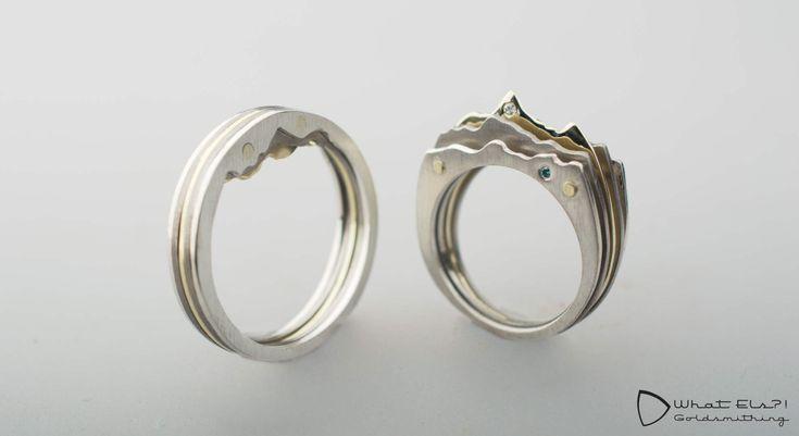 Zilveren, gouden en titanium trouwringen met diamant in de vorm van de Himalaya, de plaats waar deze mensen elkaar hebben ontmoet.