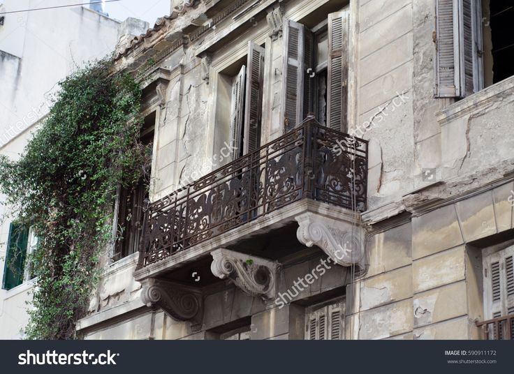 new classic house in athens first floor with crafted iron handrails, marble balconies, wooden windows, viewing angle restoration