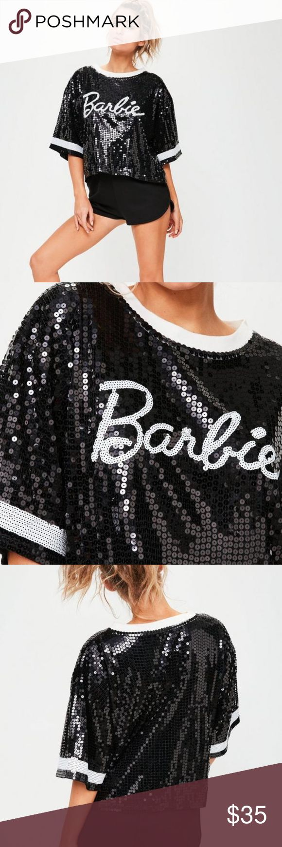 """Barbie x Missguided Black Sequin T-Shirt cover yourself in sequins and sparkle in the spotlight wearing this sequin t-shirt. featuring an all over black sequin finish with contrasting white bands, rounded neck and barbie motif.  regular / stretch fit   95% polyester 5% elastane    approx length: 51cm/20""""  Only worn once, in like new condition. Missguided Tops Crop Tops"""
