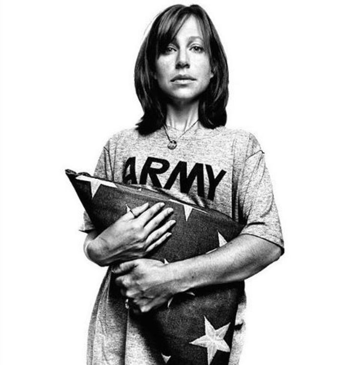 "Jessica Gray wears the shirt of her late husband, Army Staff Sgt. Yance T. Gray. He was killed in Iraq in 2007. His wedding ring rests on a chain around her neck, as her arms wrap tightly and emotionally around the folded American flag that was draped over his coffin just a few months earlier.  This portrait was shot by photographer Platon Antoniou and is part of his book ""Service."" Platon met Gray in 2008 when he began working on ""Service,"" a collection of portraits looking at the effects…"