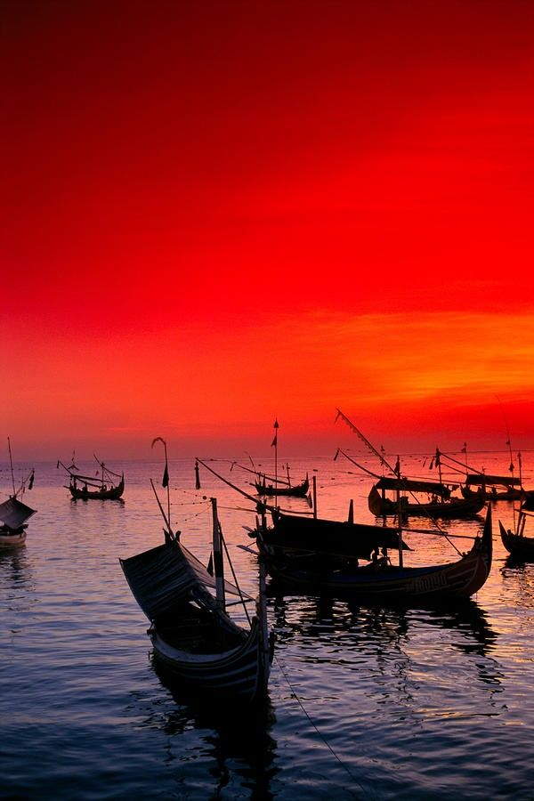 red sunset sky in Jimbaran Bay, Bali, Indonesia
