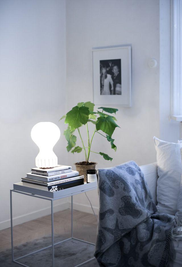 Gatto table lamp by Flos. Aristidia merino/cashmere plaid by Svenskt Tenn.