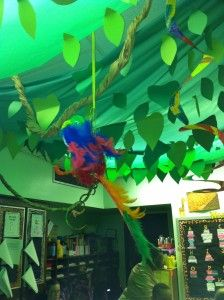 It looks as though she used a parachute on the ceiling to engulf the entire room with leaves and branches – this transformed her classroom. I also noticed the cool animal print borders around the room.  http://www.schoolgirlstyle.com/2011/09/cute-classroom-inspiration-cristina-celzo-from-bronx-new-york/#
