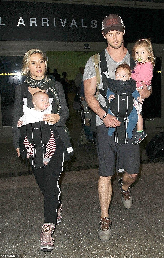 Chris Hemsworth cuts a paternal figure as he arrives in LA The actor arrived with his wife Elsa Pataky who was equally in possession of some precious goods