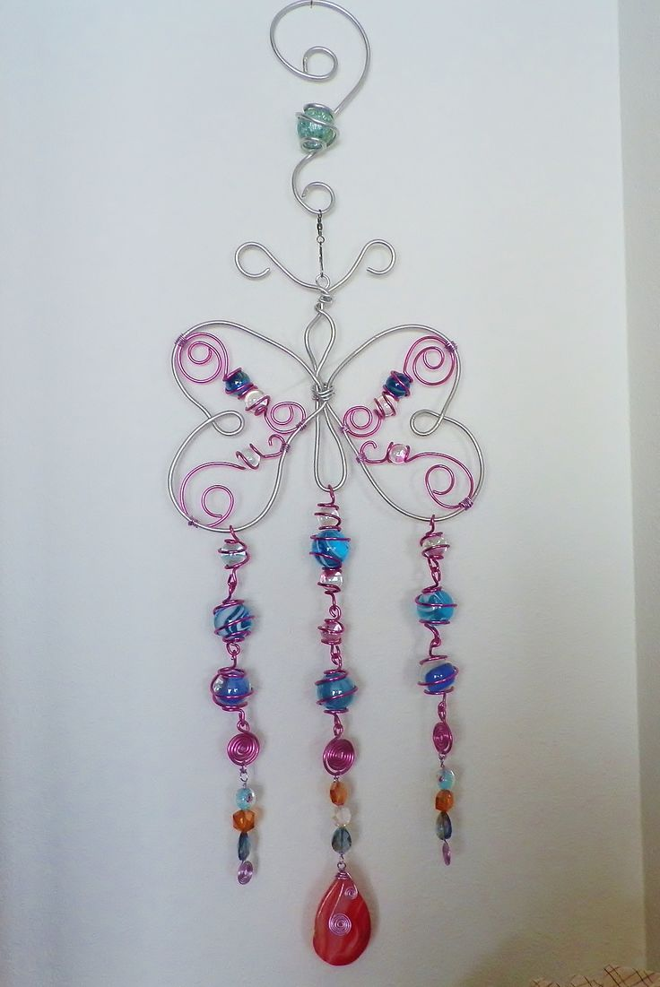 Wind chime; sun catcher; wire wrapped marbles and beads garden art butterfly.