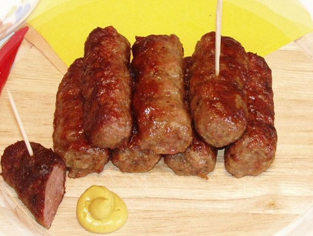 Romanian Mititei (Mici) - These little yummies are THE smell encountered at any Romanian Piatsa (outdoor market). They are the closest thing you find to Romanian street food. They are very flavorful and smell incredibly good while grilling.