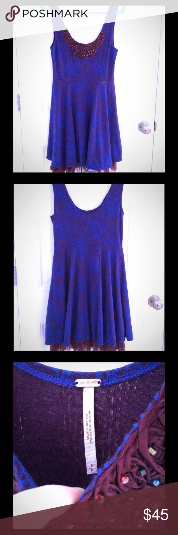 Free People Dress size Small Really comfortable Free People dress size small. This dress has a layer of maroon tulle underneath to give the dress some flare :) This dress is super flattering on! Free People Dresses