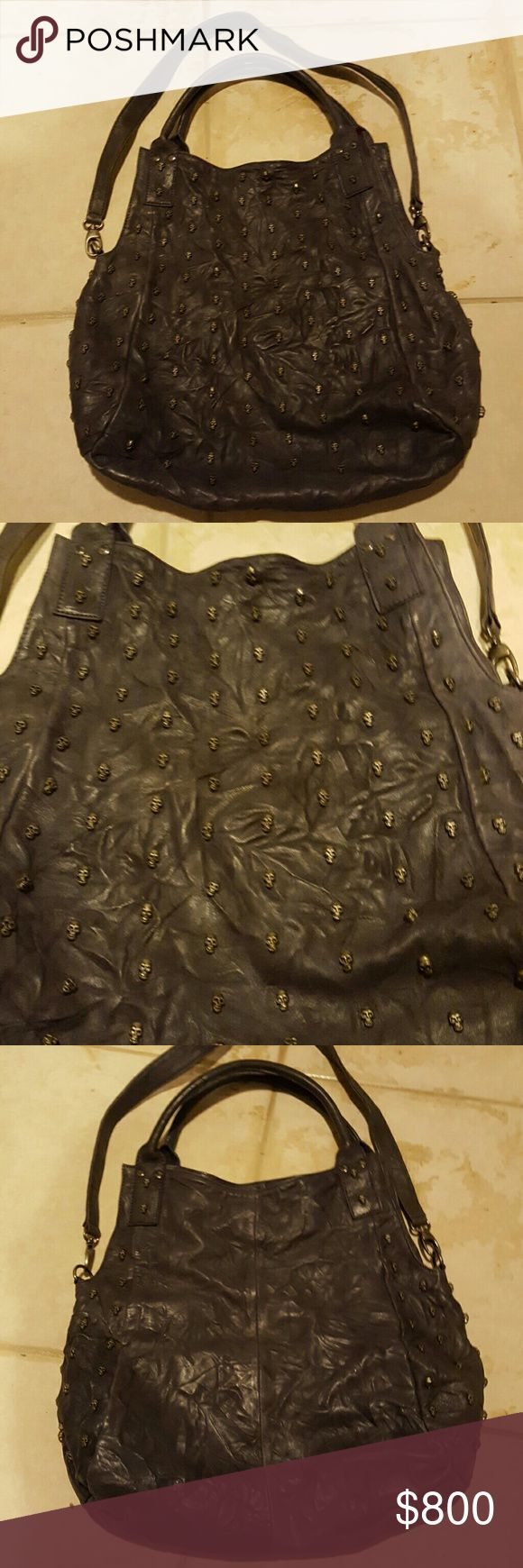 Thomas Wylde Skull Leather Purse Bag Rare Beyond breathtaking! Bag of the century and hard to find.  Authentic Thomas Wylde buttery distressed leather with carefully tooled tiny skulls all over the front.  A muted dusty purple color.  Magnetic top closure.  15 inches x 15 inches.  So stylish.  Treat yourself for that added style kick to your wardrobe.  I live by the beach and have been to scared to carry it so better I sell it to someone who will use it.  Fantastic condition. Thomas Wylde…