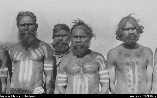 Four Australian Aboriginal men wearing body paint, Alice Springs, Northern Territory, ca. 1920 [picture].