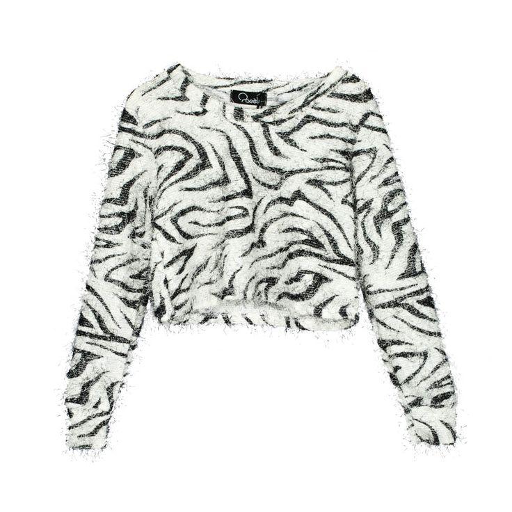 Sweater de mujer corto con animal print cebra, tela lanilla peluda