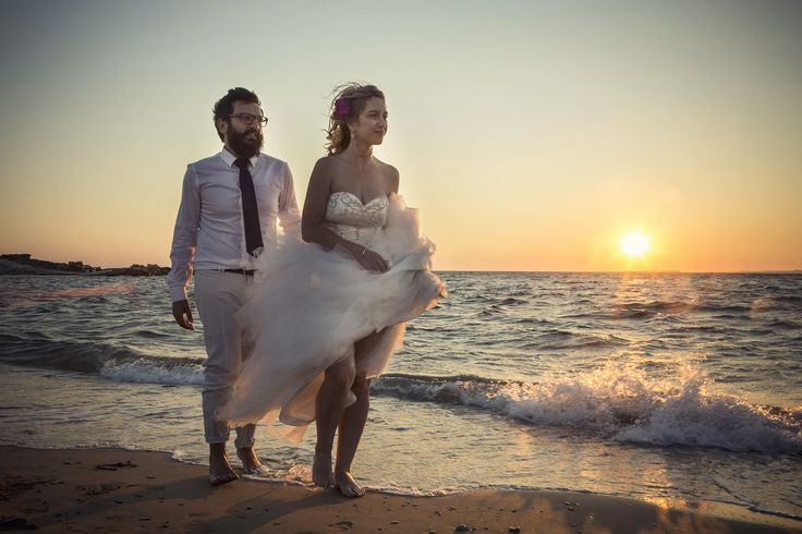 Walking on the beach together.. #beachwedding #weddingphotos #mythoswedding #kefalonia