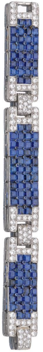 ♥ Sapphire and diamond bracelet, Cartier, circa 1930. The three calibré-cut and cabochon sapphire panels alternating with stylised buckle motifs pavé-set with brilliant- and circular-cut diamonds, mounted in platinum, length approximately 162mm, signed Cartier Made in France, numbered, French maker's mark. Sotheby's.