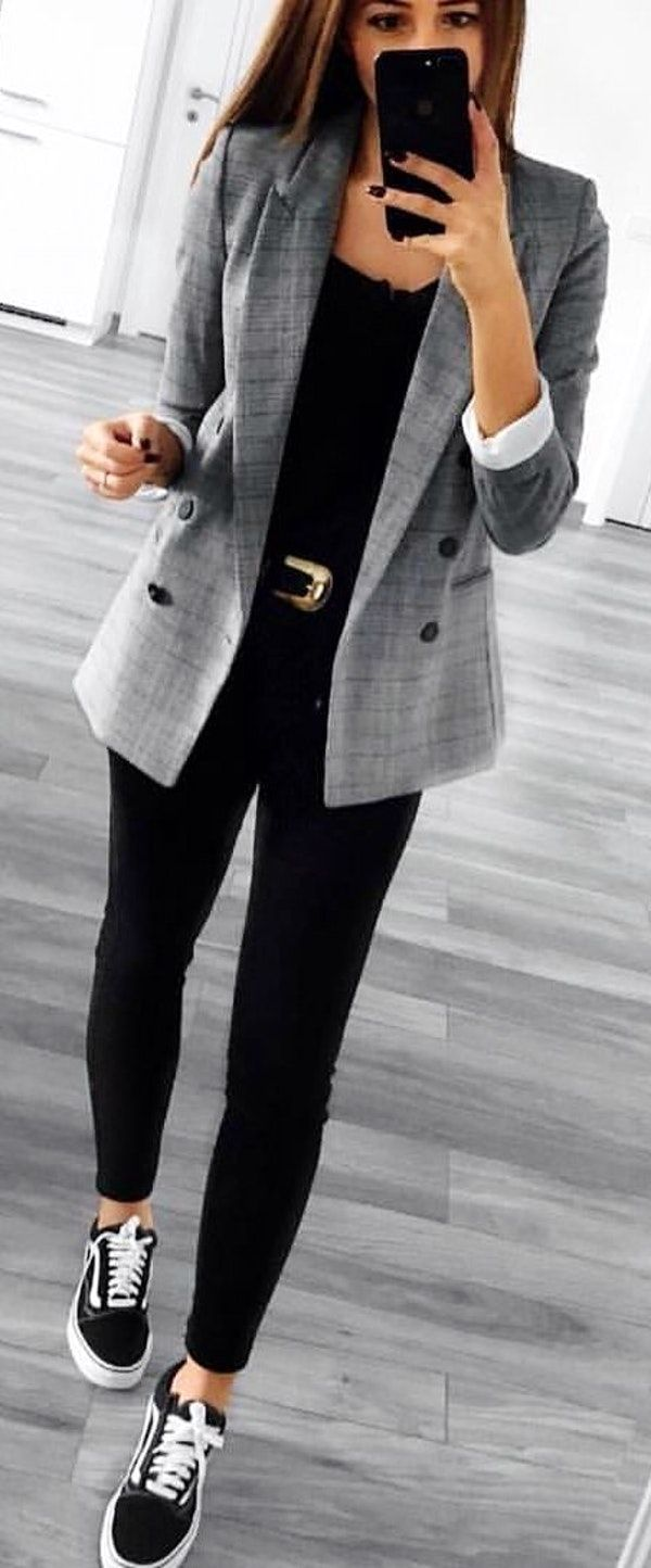 #spring #outfits woman in gray blazer and black pants holding iPhone in front of mirror. Pic by @london_style_blog