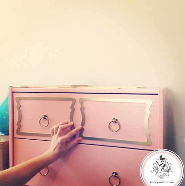 You can add hardware and decals to boring Ikea dressers for a vintage vibe...look!