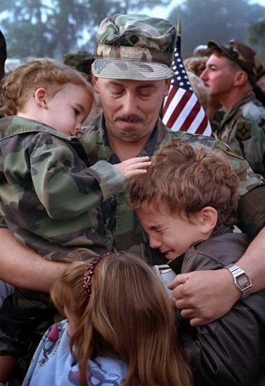 "Gulf War: A Florida reservist says an emotional goodbye to his family before being deployed. The photo is part of ""The American Soldier — A Photographic Tribute to Soldiers and Marines"" exhibit at the Gerald R. Ford Museum"