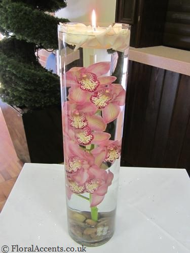 Cymbidium orchids or roses suspended under water with a