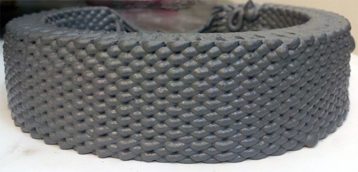 3d cement print made with recycled waste steel dust particles.