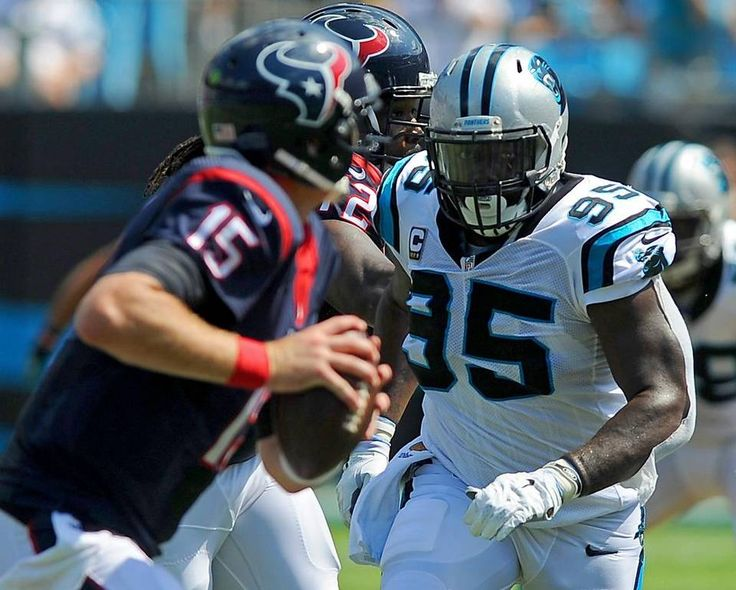 Carolina Panthers defensive end Charles Johnson, right, chases after Houston Texans quarterback Ryan Mallett, left, during second quarter action at Bank of America Stadium in Charlotte, NC on Sunday, September 20, 2015. The Panthers defeated the Texans 24-17.