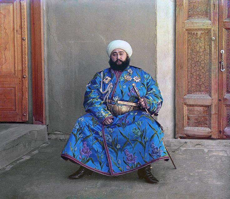 1911 The Emir of Bukhara, Alim Khan (1880-1944), poses solemnly for his portrait, taken in 1911 shortly after his accession. As ruler of an autonomous city-state in Islamic Central Asia, the Emir presided over the internal affairs of his emirate as absolute monarch, although since the mid-1800s Bukhara had been a vassal state of the Russian Empire. With the establishment of Soviet power in Bukhara in 1920, the Emir fled to Afghanistan where he died in 1944.