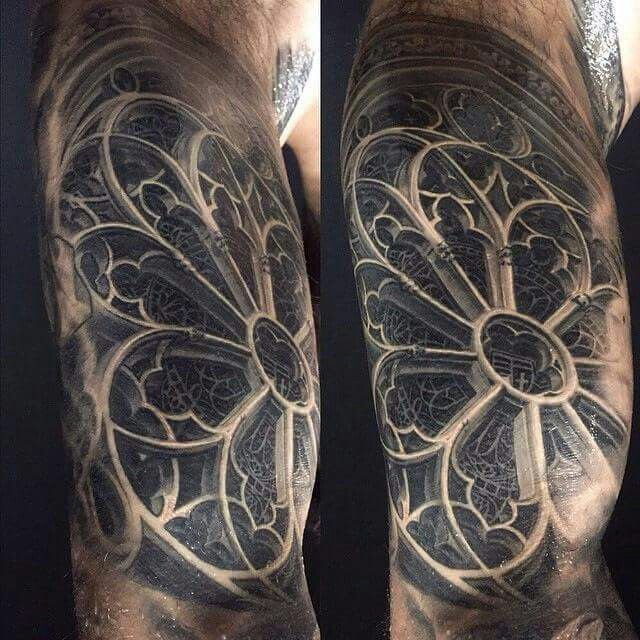 Amazing rose window tattoo by Marshall 3rd Eye...