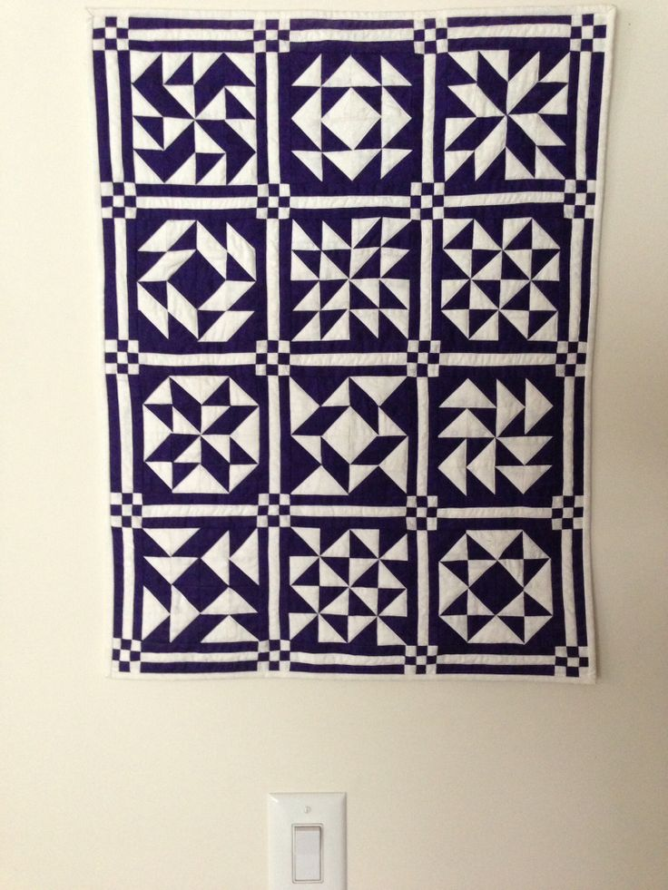Placing 1/2 square triangle blocks in different patterns. Purple & white my favorites.
