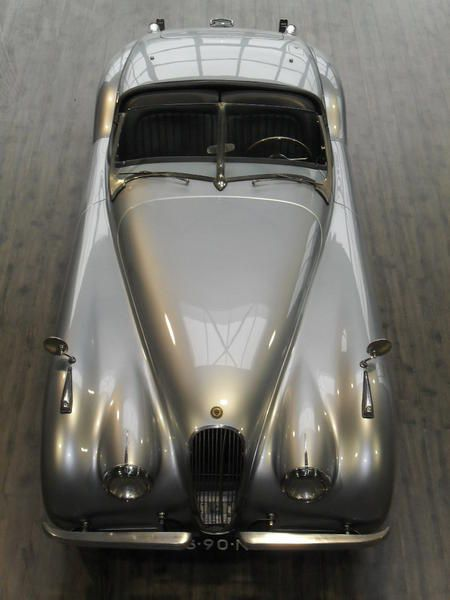 1952 Jaguar XK120. Damn! (For sale for €105,000. Hopefully they'd fix the grill for that much. Still a beautiful thing.)