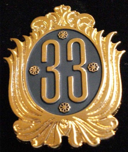 "RARE  Disneyland Club 33 Cast Costuming Pin    This pin is a Cast Costuming pin that the Cast Members in Disneyland's Club 33 wear. It is made to look like the Club 33 logo. It has a clasp back (not a straight like most pins) has the backstamp reads:    (c) Disney  Taiwan.    It measures approx. 2"" by 1 1/2"".    Only worn by the Maître d' at Club 33. Only a couple of these pins have been released."