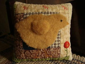 wool chick pillow - Oh, I just got a severely felted yellow wool sweater at Salvation Army for .79! Now I know what I'm going to do with!!!