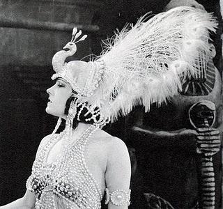 Orientalist Fantasy. Gloria Swanson, silent movie era. Fabulous peacock headdress!