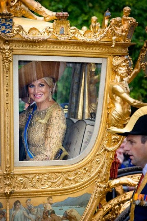 Dutch Queen Maxima arrive by the golden carriage at the Ridderzaal (Hall of Knights) at Prinsjesdag (Princes day), the traditional opening of the parliamentary year in The Hague, The Netherlands, 17 Sep 2013