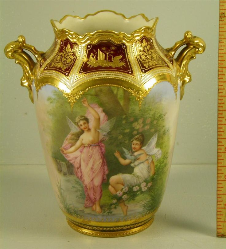 Royal Vienna Gilded Porcelain Figural Vase Signed Wagner Hand Painted. Winged ladies with cherubs on other side.