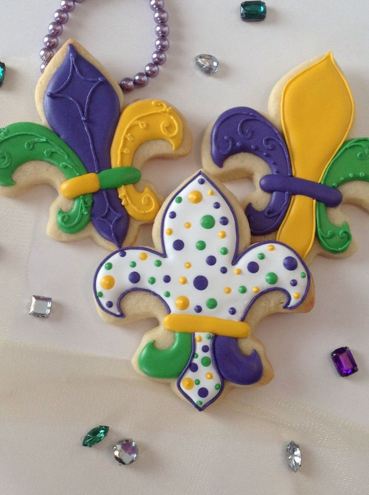 Mardi Gras Cookies - one dozen - decorated cookies by CopCakes50 on Etsy https://www.etsy.com/listing/217388208/mardi-gras-cookies-one-dozen-decorated