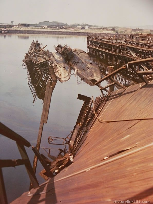 Two wrecked German submarines at dockside in Hamburg, Germany, after Allied bombing. Shipyards were rebuilt a few times, but after the heavy...