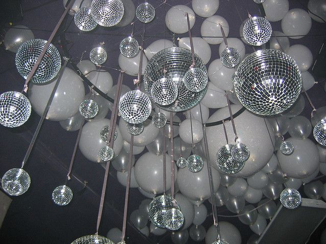 Shiny disco balls and glitter balloons- huge impact for little to no cost. We could rent the disco balls.