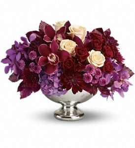 orchids, roses, hydrangea, etc in low footed bowl