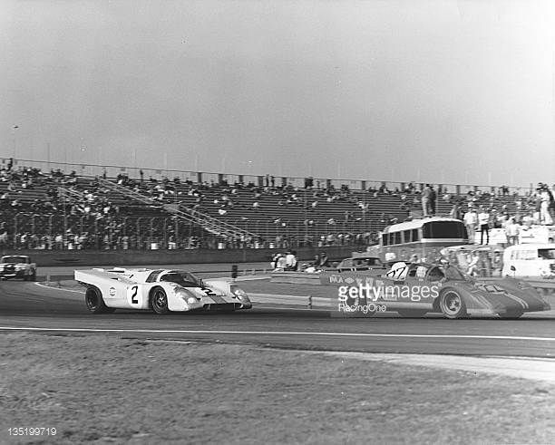 The No 22 Ferrari 512LM of Peter Revson Sam Posey Chuck Parsons and Luigi Chinetti Jr Leads the racewinning Porsche 917K of Pedro Rodriguez and...